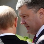 Poroshenko talks to Putin after a group photo  in Benouville